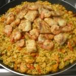 Paella; Tilapiafilet, grote Garnalen en Groenten