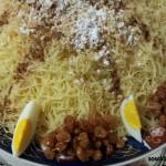 Madfouna: Gebraden Kip met Saus, Vermicelli, gekonfijte Rozijnen, Amandelen, Kaneel, Poedersuiker en Ei